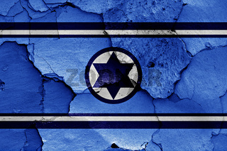 flag of Israel Air Force painted on cracked wall