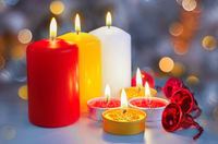 Christmas card with colorful candles. Selective focus.