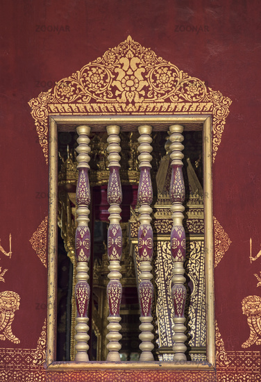 Window accented with Khmer-style wooden balustrades, Temple Wat Sensoukharam,  Luang Prabang, Laos