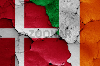 flags of Denmark and Ireland painted on cracked wall