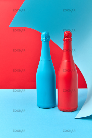 Decorative composition of two painted wine mock up bottles.