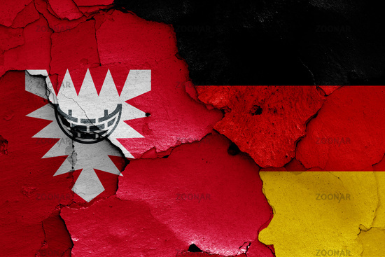 flags of Kiel and Germany painted on cracked wall