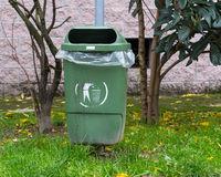 Green dumpster of garbage