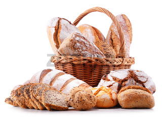 Composition with assorted bakery products in wicker basket isolated on white