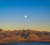Moonrise over the rugged mountains in Provo Canyon