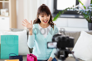 female blogger making video blog about shopping