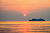 Travel by Cruises ship in the ocean at sunset