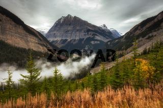 The Rocky Mountains in British Columbia on an overcast autumn day