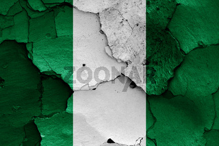 flag of Nigeria painted on cracked wall