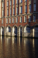old office building reflected in the Alsterfleet