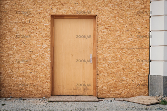 Temporary entrance door , wooden door made of chipboard  -