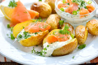 Baked baby potatoes with herb curd and salmon