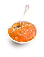 Tasty apricot jam in bowl.