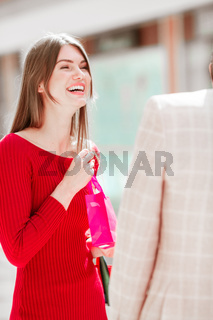 Laughing woman with gift