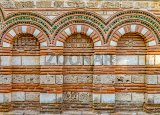Church of Saint Paraskevi in Nessebar ancient city. Nesebar, Nesebr is a UNESCO World Heritage Site. An ancient Byzantine architecture church in Nessebar, Bulgaria. Arches  details of the decoration