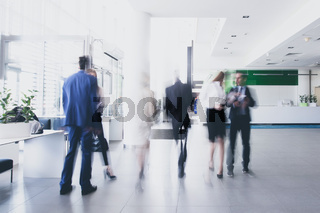 Businesspeople walking in corridor