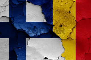 flags of Finland and Romania painted on cracked wall