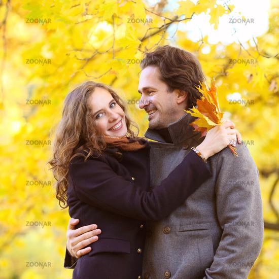 Couple hug in autumn park