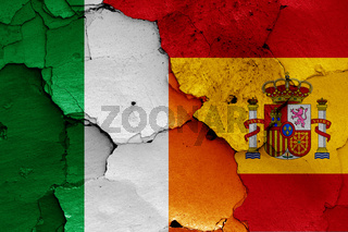 flags of Ireland and Spain painted on cracked wall