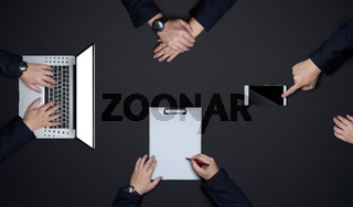 Group of business people working together . Flat lay and top view with copy space on black background .Business brainstorming meeting concept.