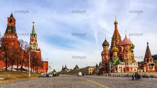Tourists visiting St Basils Cathedral, Beautiful Spasskaya Tower and The Tsars Tower on the Red Squa