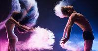 Sporty couple in color dust cloud studio shot