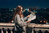 girl with a map on the background of the night city