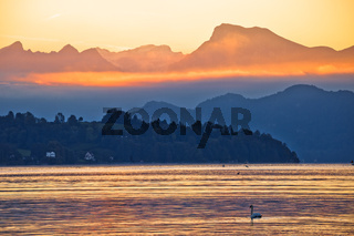 Lake Luzern and Rigi mountain peak morning golden glow view