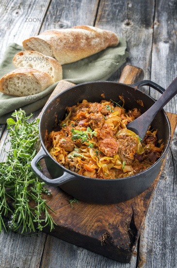 Traditional Polish kraut stew bigos with sausage