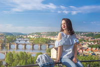 Beautiful woman and Vltava river in Prague