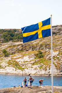 Bathing place in the archipelago with Swedish flag