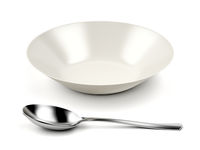 White empty bowl and silver spoon