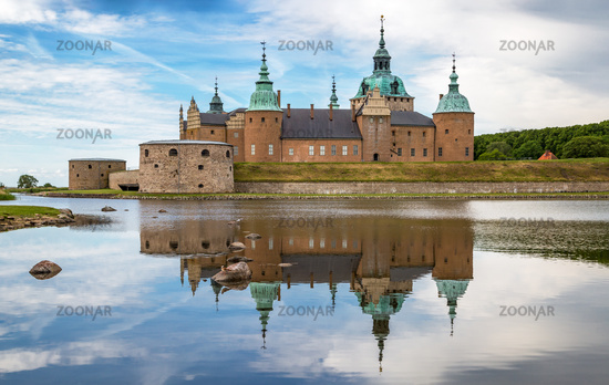Kalmar Castle on a quiet summer morning with reflection in the calm water in the foreground.