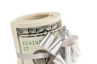Roll of One Hundred Dollar Bills With Silver Bow on White