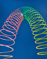 Stretching slinky toy in the shape of parabola.