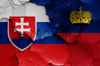 flags of Slovakia and Liechtenstein painted on cracked wall