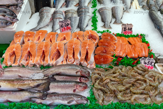 Salmon and prawns for sale at a market in London, UK