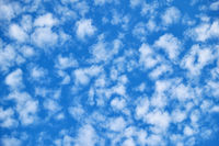 Blue sky with lots small white clouds