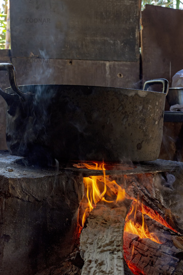 Old brazilian wood burning stove with big pan
