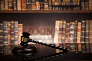 law theme, mallet of the judge, justice scale, books, wooden desk