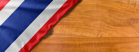 National flag of Thailand on a wooden background with copy space