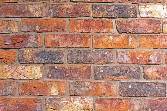 Background from a rugged red brick wall