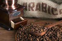 coffee beans with a burlap and wooden spoon