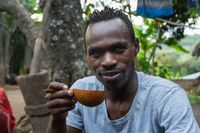 Ethiopian man drinking coffee