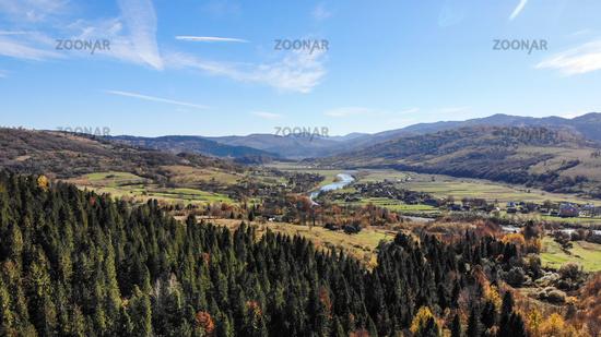 Village in valley of Carpathian Mountains, Ukraine. Beautiful nature, autumn landscape
