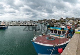 fishing boats and yacht marina in the harbor of Saint Vaast la Hougue in Normandy