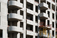 building shell of apartment building under construction - real estate
