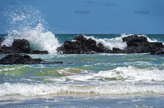 Waves breaking at the lava rocks of the coast, Isabela Island, Galapagos Islands, Ecuador