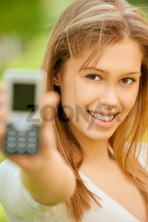 a beautiful young woman in a white dress show of mobile phone