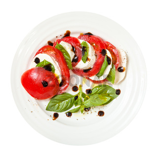 top view mozzarella and tomato with basil leaves